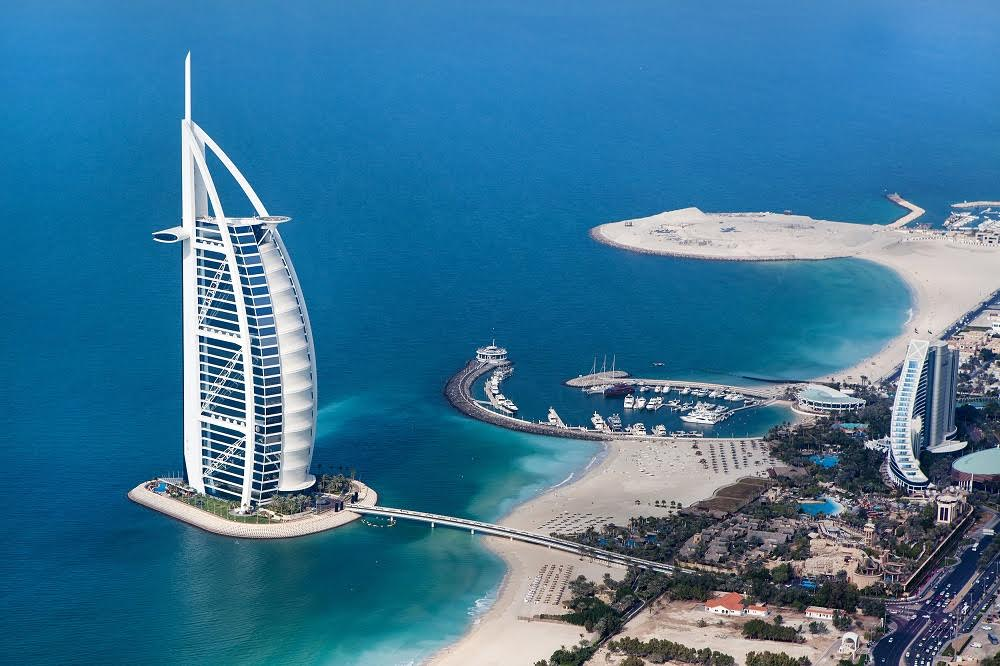 DUBAI, UAE - JANUARY 20: Burj Al Arab hotel on January 20, 2011 in Dubai, UAE. Burj Al Arab is a luxury 5 star hotel built on an artificial island in front of Jumeirah beach; Shutterstock ID 125624981; PO: bosolo
