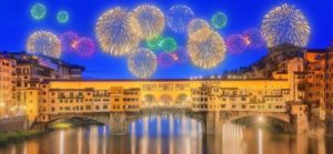 View of medieval stone bridge Ponte Vecchio and the Arno River from the Ponte Santa Trinita (Holy Trinity Bridge) in Florence, Tuscany, Italy. Florence is a popular tourist destination of Europe.; Shutterstock ID 374509369; PO: immagini ufficio stampa